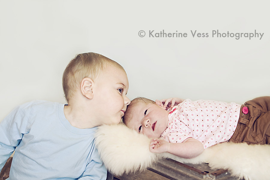 big brother kissing baby sister