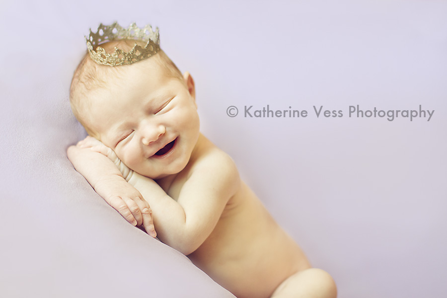 sweet newborn girl with princess crown