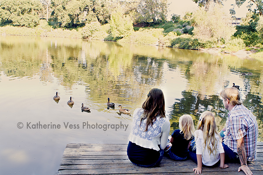 family watching some duckies swim by in Davis, CA