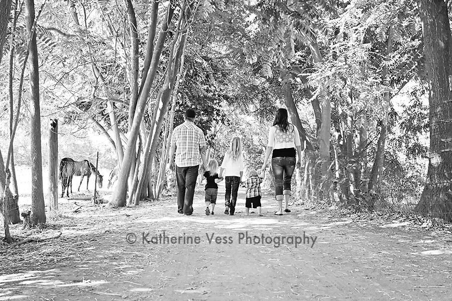 family holding hands taking a stroll in Davis, CA