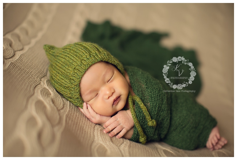 newborn boy in green
