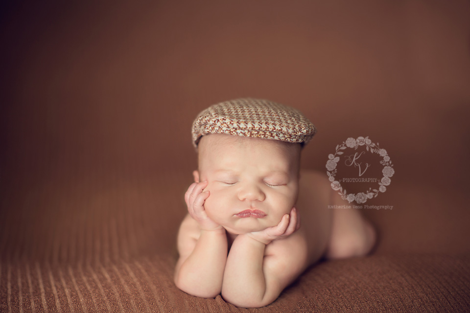 newborn in newsboy hat