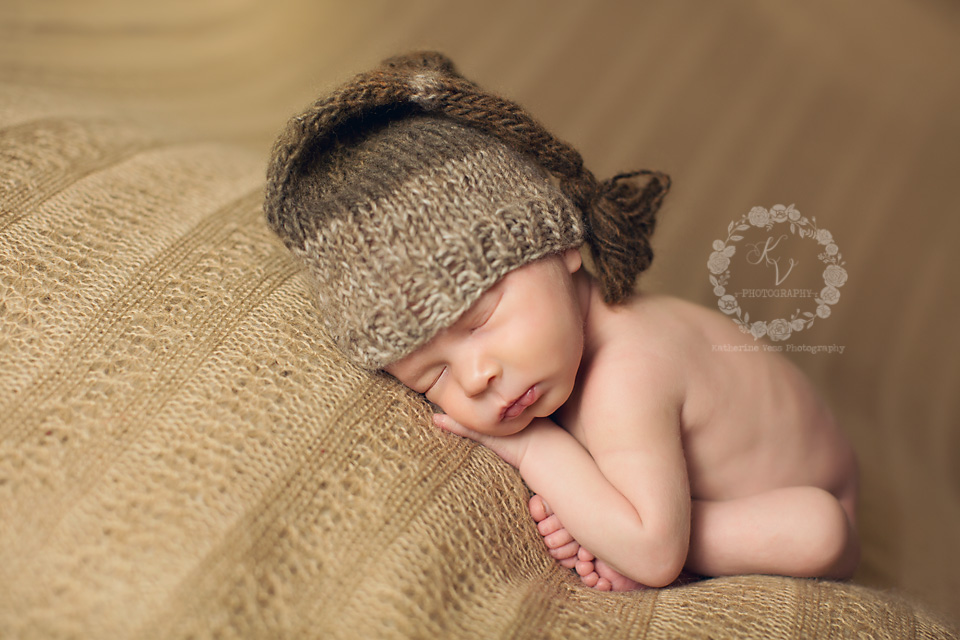 newborn in tassel hat